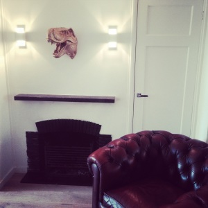 White Faux Taxidermy Golden T-Rex and Chesterfield at www.littlebrookroad.com. Home Interior design trends inspiration and ideas styling art